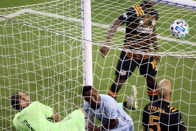 KANSAS CITY, KANSAS - AUGUST 25:  Gadi Kinda #17 of Sporting Kansas City falls into the goal as he scores during the 2nd half of the game against the Houston Dynamo at Children's Mercy Park on August 25, 2020 in Kansas City, Kansas. Photo: Jamie Squire, Getty Images / 2020 Getty Images