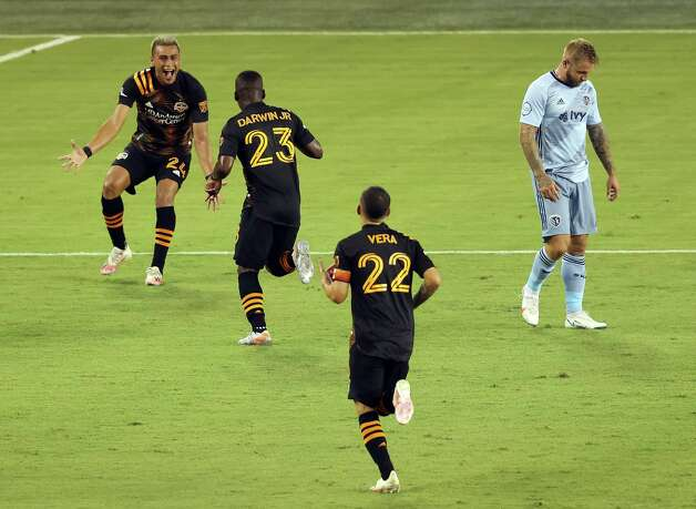 KANSAS CITY, KANSAS - AUGUST 25:  Darwin Ceren #24 of Houston Dynamo celebrates with Carlos Darwin Quintero #23 and Matias Vera #22 after a goal by Quintero during the 2nd half of the game against the Sporting Kansas City at Children's Mercy Park on August 25, 2020 in Kansas City, Kansas. Photo: Jamie Squire, Getty Images / 2020 Getty Images