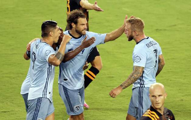 KANSAS CITY, KANSAS - AUGUST 25:  Johnny Russell #7 of Sporting Kansas City is congratulated by Graham Zusi #8 and Alan Pulido #9 after scoring during the 1st half of the game against the Houston Dynamo at Children's Mercy Park on August 25, 2020 in Kansas City, Kansas. Photo: Jamie Squire, Getty Images / 2020 Getty Images