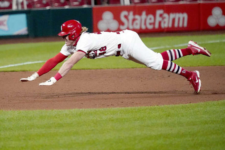 The Cardinals' Harrison Bader dives into third for a triple during the ninth inning of a baseball game against the Kansas City Royals Tuesday, Aug. 25, 2020, in St. Louis. (AP Photo/Jeff Roberson) Photo: AP Photo