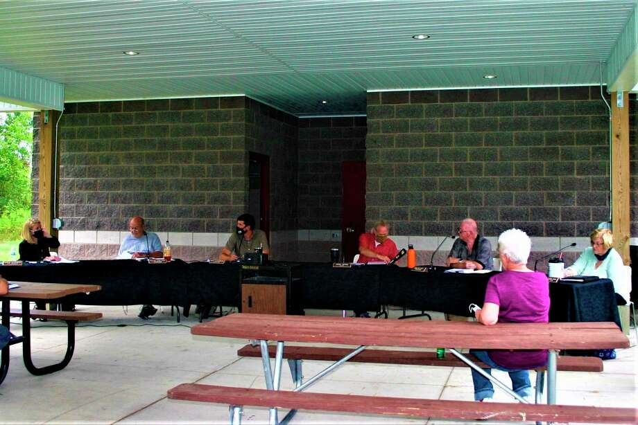 Evart City Council met outdoors at the Riverside East pavilion for their regular meeting on Aug. 24.(Herald Review photo/Cathie Crew)