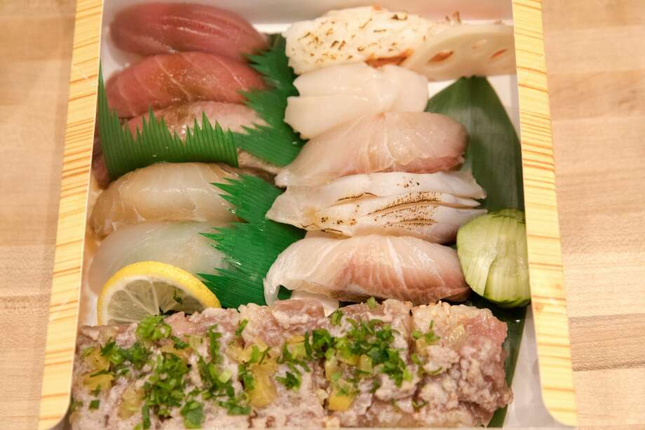 One of the takeout omakase orders at Oma San Francisco Station for customers on Aug. 21, 2020. Restaurants inside the Japan Center malls have had to resort to takeout services, many located at tents set up on the center's plaza. Photo: Douglas Zimmerman/SFGATE / SFGATE