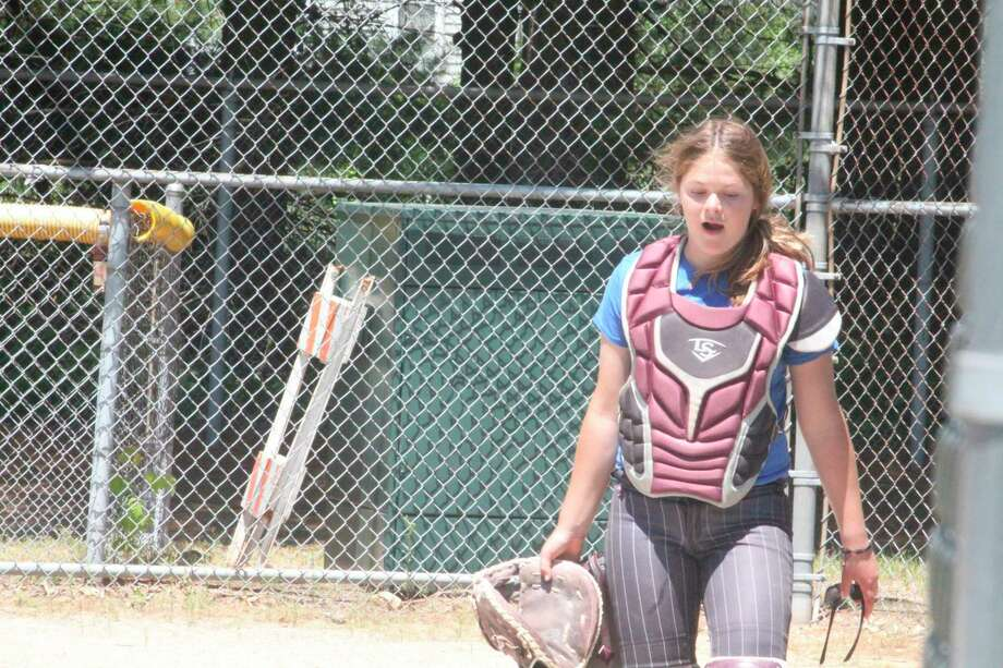 Evart's Ally Theunick works on her catching duties during a practice with the Michigan Expos. (Herald Review photo/John Raffel)