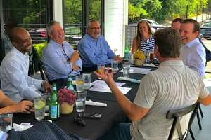 Restaurant owners and managers met with Sen. Chris Murphy, right, at the Wood-n-Tap in Farmington Tuesday, August 25, 2020. Also pictured, a lunch crowd at the Wood-n-tap under a tent on the Farmington River.