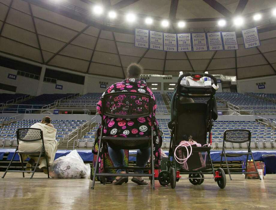Southwest Louisiana residents wait for buses at Burton Coliseum in Lake Charles, La. to be evacuated to a shelter in Alexandria, La., Tuesday, Aug. 25, 2020. (Rick Hickman/American Press via AP) Photo: Rick Hickman, AP / American Press