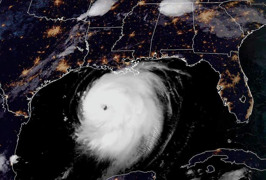 """This RAMMB/NOAA satellite image shows Hurricane Laura moving Northwestern in the Gulf of Mexico towards Louisiana at 11:40 UTC on August 26, 2020. - Texas and Louisiana residents evacuated flood zones and boarded up windows August 25, 2020 as Hurricane Laura barreled towards the coastline, after earlier causing 25 deaths in the Caribbean. The storm's maximum sustained winds were nearing 90 mph (150 km/h), with gusts higher, the US National Hurricane Center (NHC) reported, and forecasters expect it to strengthen significantly in the next 24 hours. """"Laura is expected to be a major hurricane at landfall,"""" the center said. (Photo by Handout / RAMMB/NOAA/NESDIS / AFP) / Photo: HANDOUT, Contributor / RAMMB/NOAA/NESDIS/AFP Via Getty Images / AFP or licensors"""