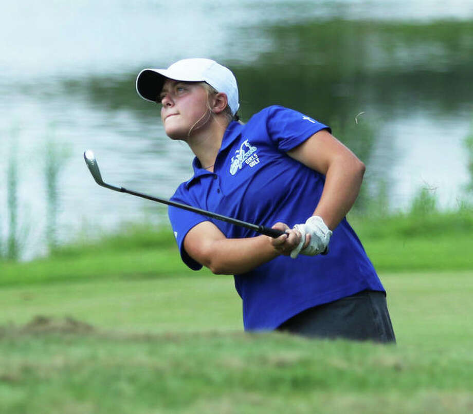 Marquette Catholic's Audrey Cain watches her shot to the green on hole No. 18 at the Metro East Shootout on Tuesday at Far Oaks Country Club in Caseyville. Cain posted a top-10 finish with an 80 to help the Explorers place third. Photo: Greg Shashack / The Telegraph