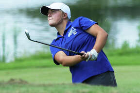 Marquette Catholic's Audrey Cain watches her shot to the green on hole No. 18 at the Metro East Shootout on Tuesday at Far Oaks Country Club in Caseyville. Cain posted a top-10 finish with an 80 to help the Explorers place third.