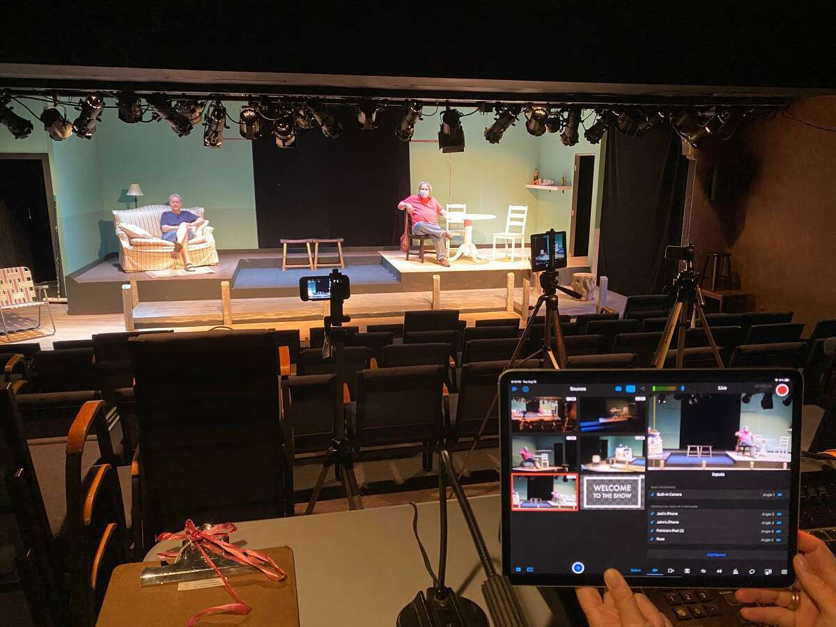 Joel Reynolds, master carpenter, and John Zimmerman, tech crew test camera angles for the Town Players live streaming performance of The Outgoing Tide.