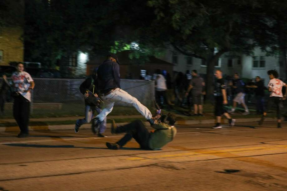 KENOSHA, WISCONSIN, USA - AUGUST 25: Clashes between protesters and armed civilians, who protect the streets of Kenosha against the arson, break out during the third day of protests over the shooting of a black man Jacob Blake by police officer in Wisconsin, United States on August 25, 2020. (Photo by Tayfun Coskun/Anadolu Agency via Getty Images) Photo: Anadolu Agency/Anadolu Agency Via Getty Images / 2020 Anadolu Agency