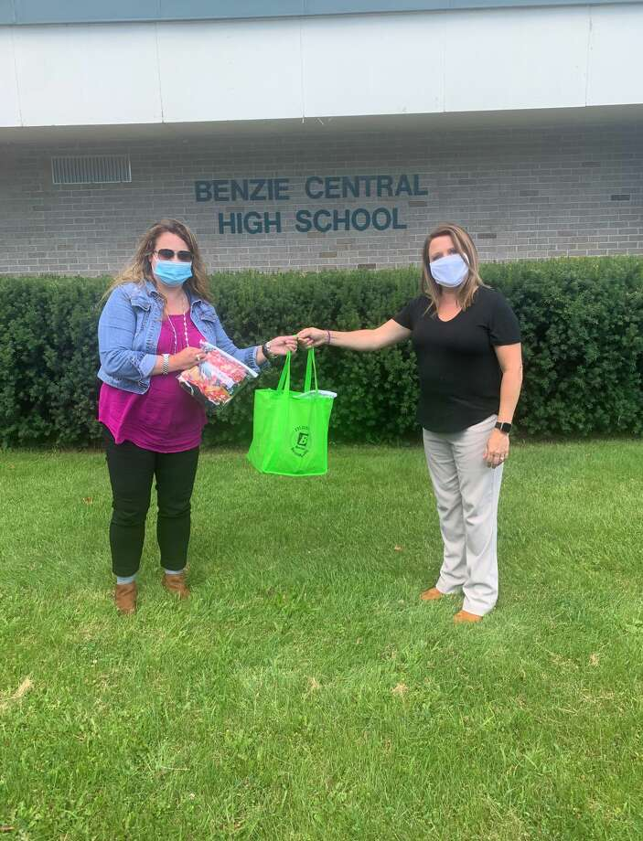Jessica Carland, mobility manager for Benzie Bus receives over 400 masks from Helene Gidley. (Courtesy Photo) Photo: (Courtesy Photo)
