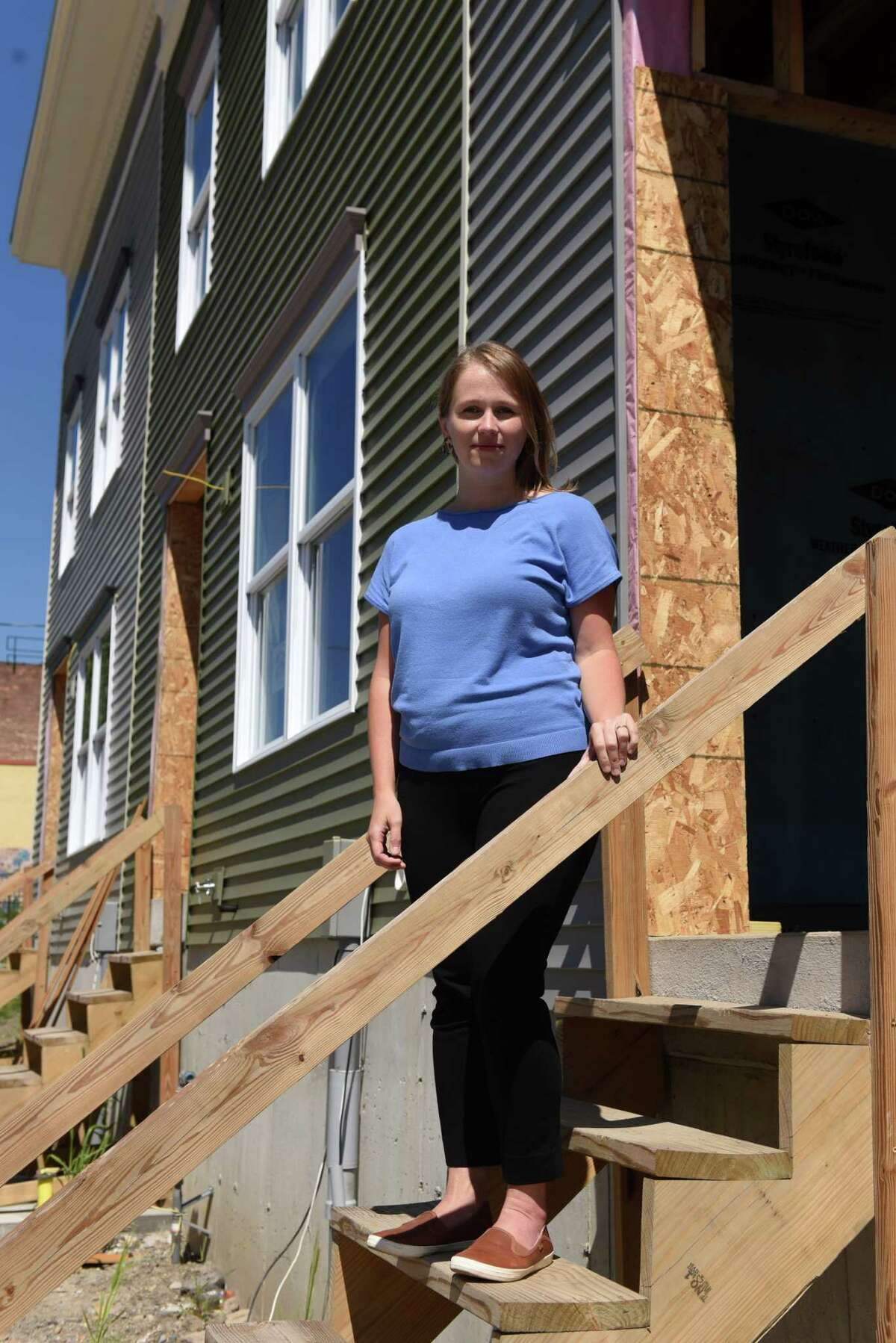 Christine Schudde, executive director of Habitat for Humanity of the Capital District, is pictured on Friday, Aug. 21, 2020, outside an Orange Street Habitat house under construction in Albany, N.Y. (Will Waldron/Times Union)