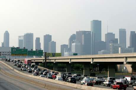 Congestion backs up traffic on I-45 heading north into downtown Houston as coastal residents heed warnings of Hurricane Rita Wednesday, September 21, 2005. (MIKE KANE/STAFF)