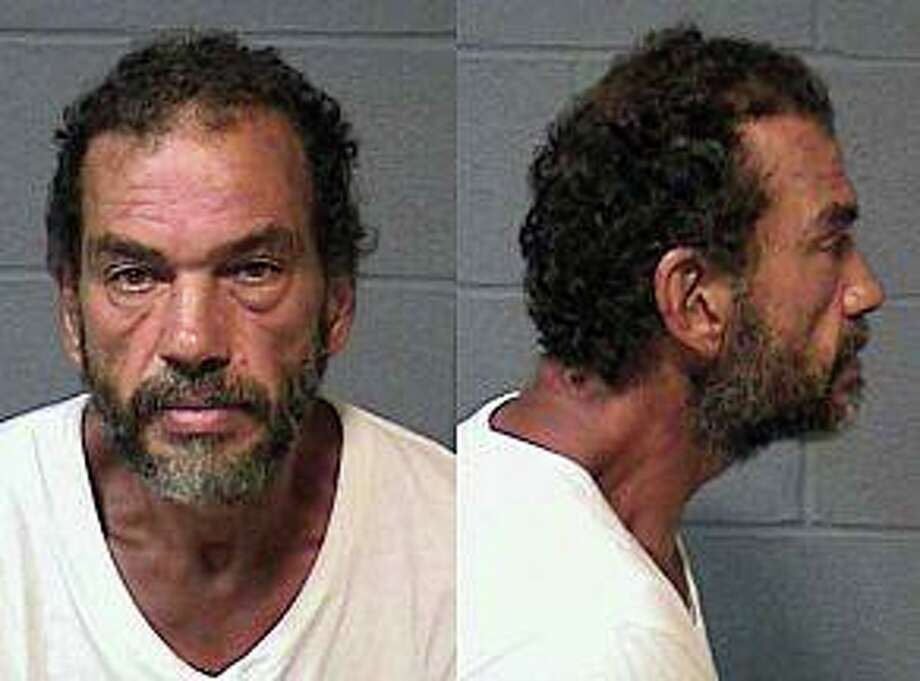 """A 53-year-old Hartford man accused of stealing 13 bottle of booze, is also a """"person of interest"""" in several burglaries in the city, police said. The suspect - Orlando Garcia, 53, of Hendricksen Avenue - was charged with third-degree burglary, sixth-degree larceny and violation of probation. He was held on $75,000 bond. Photo: Hartford Police Photo"""