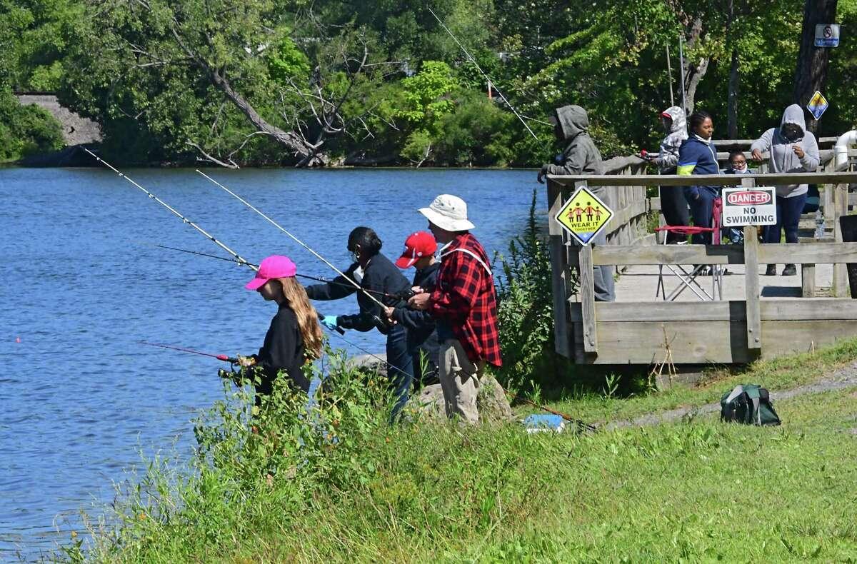 People are seen fishing in Rensselaer Lake at Six Mile Waterworks Park on Wednesday, Aug. 26, 2020 in Albany, N.Y (Lori Van Buren/Times Union)