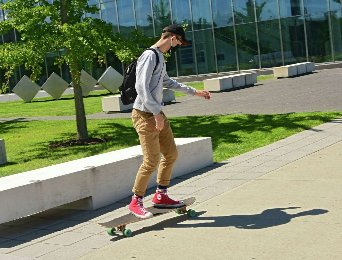 A student is seen getting around campus on a longboard at University at Albany on Wednesday, Aug. 26, 2020 in Albany, N.Y (Lori Van Buren/Times Union)