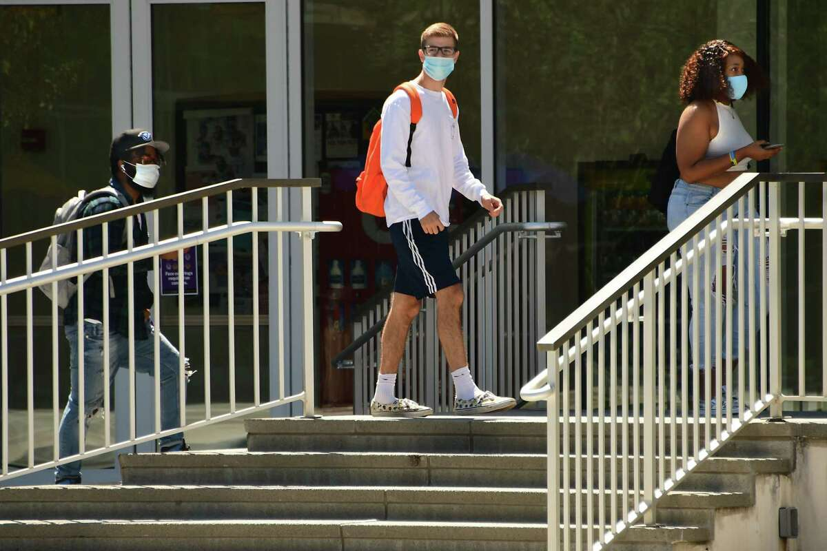Students are seen walking out of classes near a press conference to address COVID safety protocols and screening practices now that classes have resumed for the fall 2020 semester at University at Albany on Wednesday, Aug. 26, 2020 in Albany, N.Y (Lori Van Buren/Times Union)