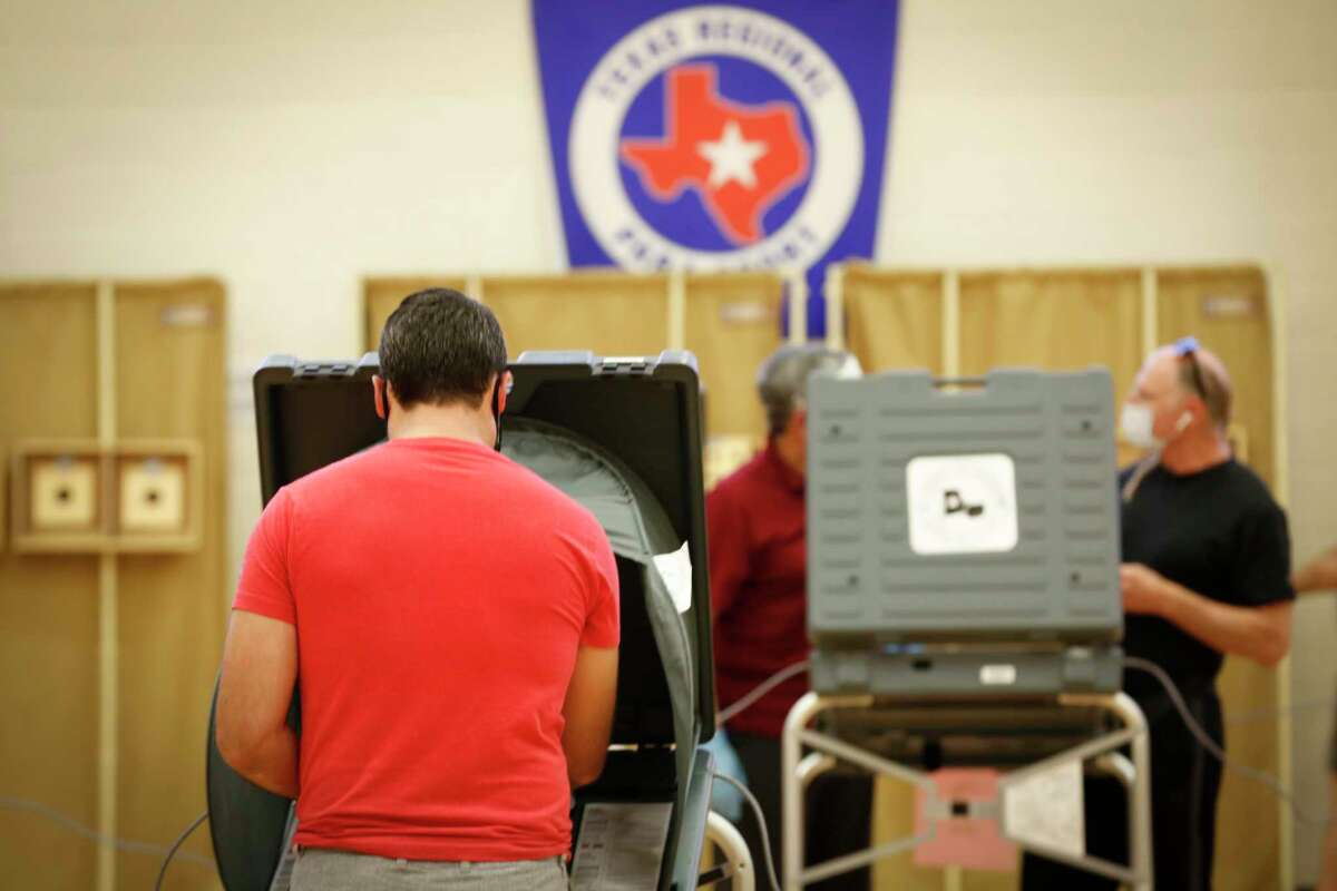 Voters cast their ballots at the Metropolitan Multi-Services Center, 1475 West Gray St., Tuesday, July 14, 2020, in Houston.