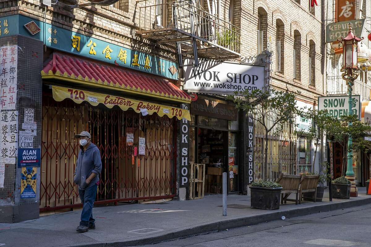 Shuttered businesses line Grant Avenue in S.F.'s Chinatown in August, months into the pandemic.