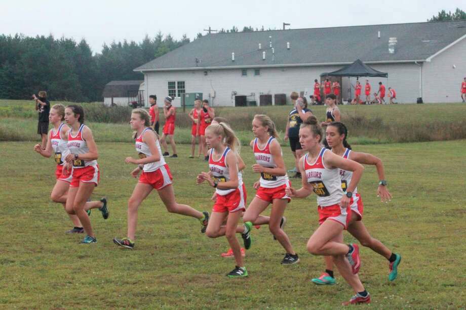 Chippewa Hills girls runners get off to the start of their home Wednesday cross country race. (Pioneer photo/John Raffel)