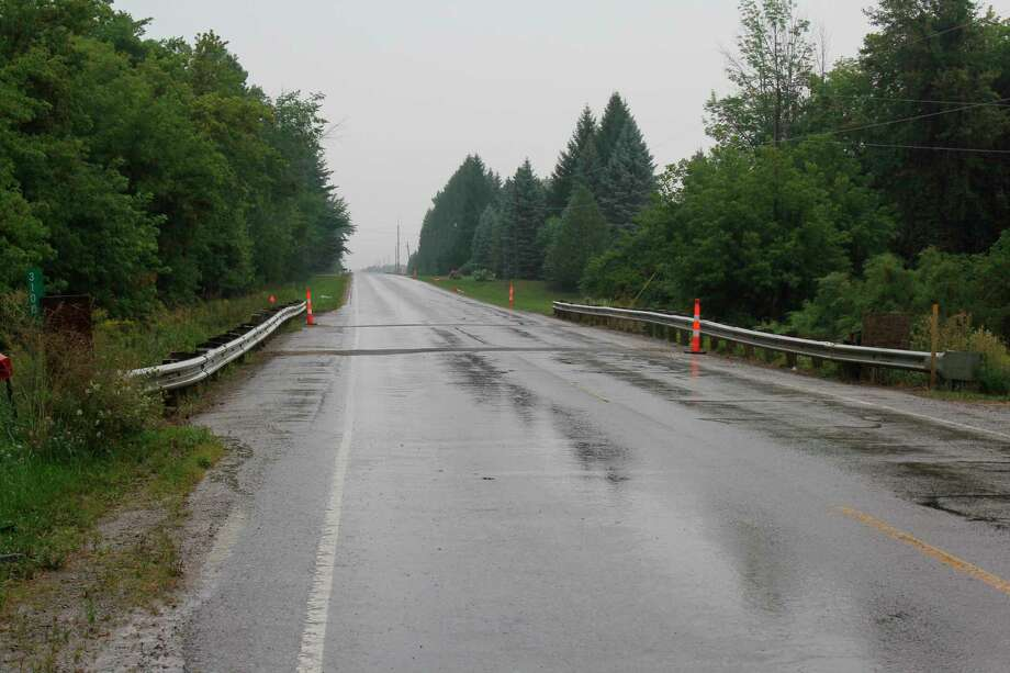 This bridge on Pinnebog Road over Bad Axe Creek is due to be looked at as part of planned road work. The Huron County Road Commission is set to repave the road over the next few weeks. (Robert Creenan/Huron Daily Tribune)