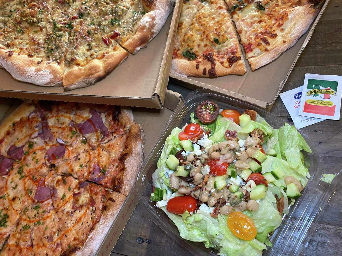 Menu options include, clockwise from top left, a Clams Casino pizza, a Hash Brown pizza, a chopped salad and a Smoked Mozzarella pizza at Barbaro, an Italian restaurant, bar and pizzeria in Monte Vista.
