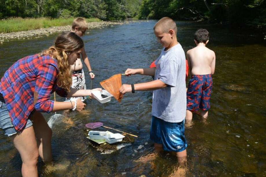 The Institute for American Indian Studies in Washington is holding family programs this weekend. Families can take a walk along the Shepaug River to learn about the insects, animals and fish living there, at 2 p.m. Aug. 29. Photo: IAIS / Contributed Photo /