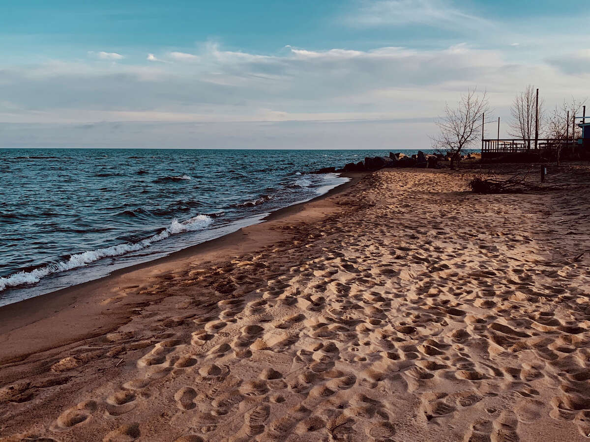 The shoreline of the beach at Tawas Point State Park, one of many parks available to Michiganders this summer. With many people vaccinated, getting back out and lying on the beach, playing in the waves or building a sandcastle while basking in the sun and taking in the outdoors could be a comforting option for Independence Day.