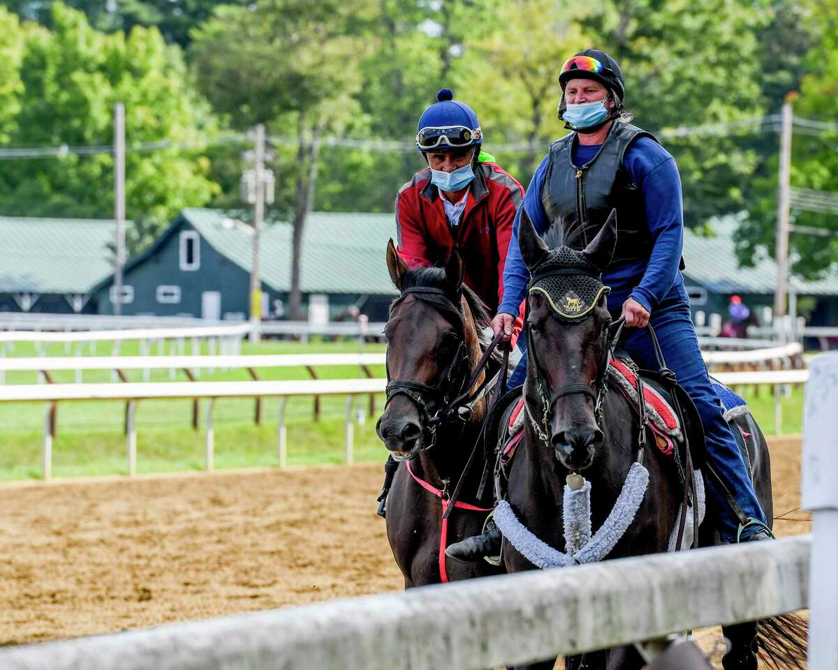 Kentucky Derby hopeful Caracaro, left goes out for a jog on the main track Wednesday Aug.26, 2020 at the Saratoga Race Course in Saratoga Springs, N.Y. Photo by Skip Dickstein/Special to the Times Union
