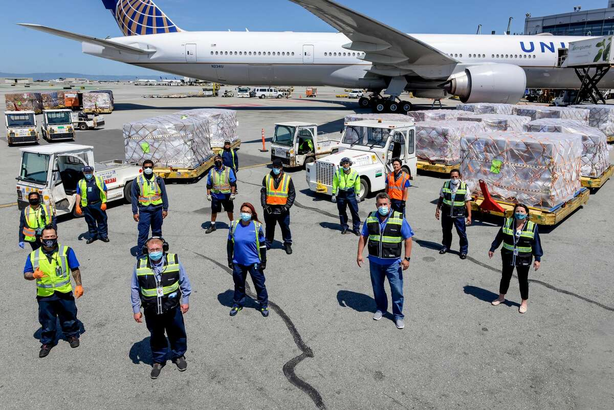 Airline ramp workers are busier than ever with cargo, less so with passenger bags due to flagging demand.