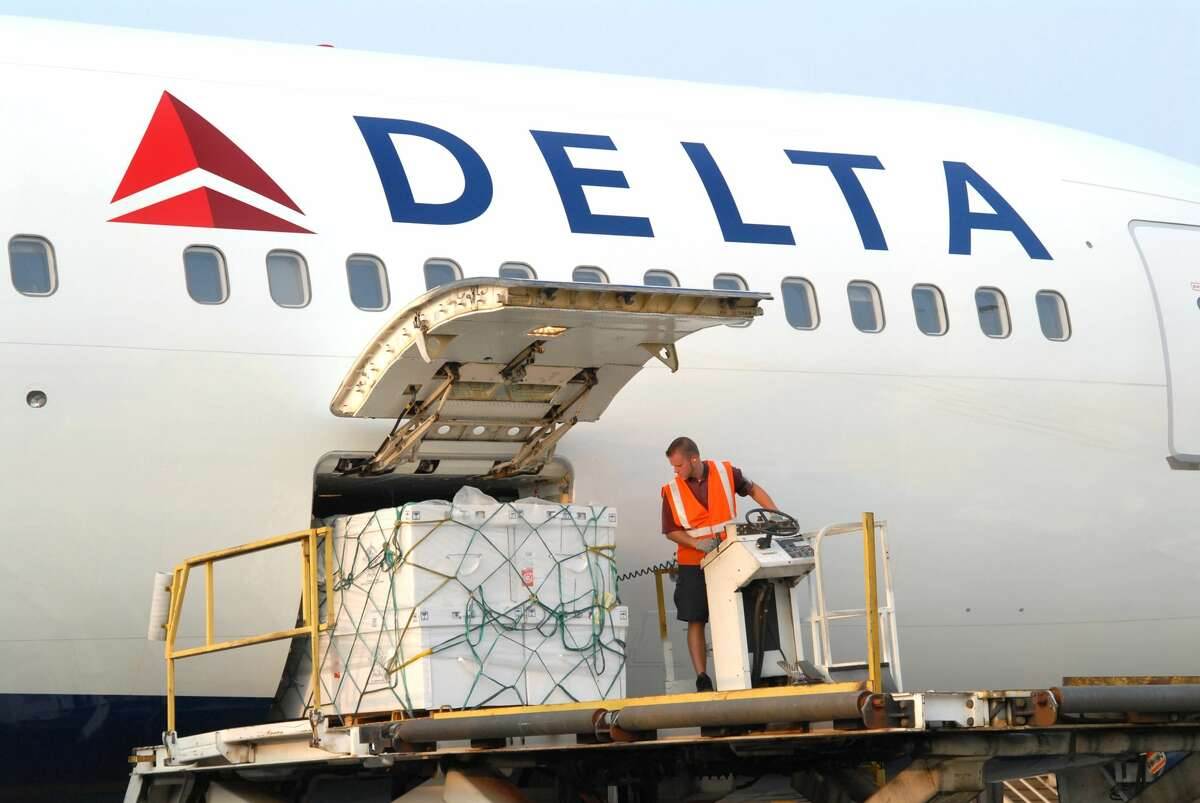 James Jones Airline ramp workers are busier than ever with cargo, less so with passenger bags due to flagging demand.