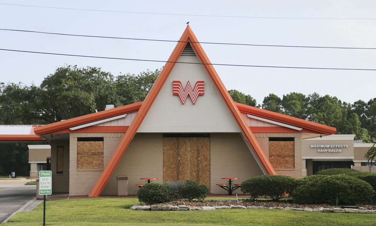 Whataburger is boarded up in Orange, Texas on Wednesday, Aug. 26, 2020.