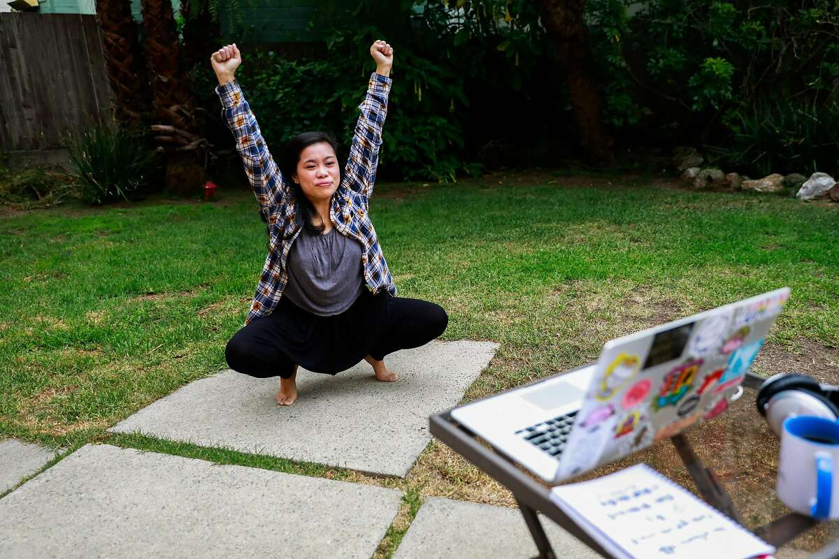 Nikki Me-ez practices mindfulness yoga exercises as a demonstration for the Chronicle in her back yard on Wednesday, Aug. 12, 2020 in San Francisco, California.