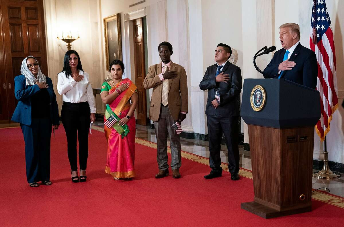 President Donald Trump participates in a naturalization ceremony at the White House in Washington, during the Republican National Convention, on Tuesday, Aug. 25, 2020. Needing ratings and a reinvention, the president used the White House as game show set and official acts as the fabulous winnings. (Doug Mills/The New York Times)