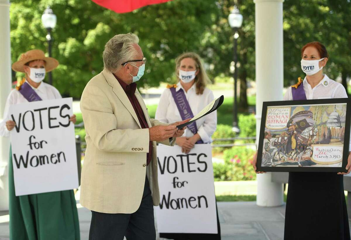 Norwalk Mayor Harry Rilling reads a proclamation naming Women's Equality Day on the 100th anniversary of the passing of the 19th Amendment in Norwalk, Conn. on Tuesday, August 25, 2020. From left are Norwalk League of Women Voters members Mary Oster, Laura Smits, and Elsa Obuchowski.
