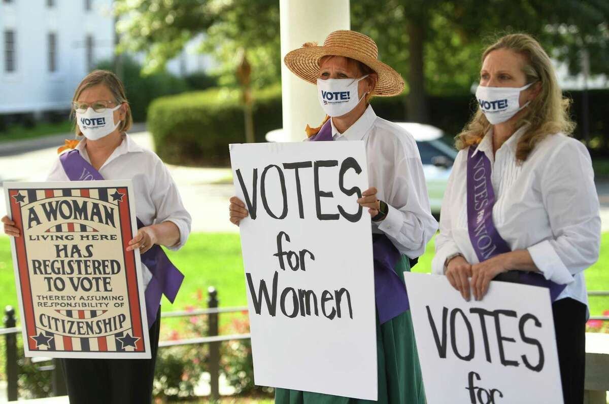From left; Norwalk League of Women Voters members Debra D'Arinzo, Mary Oster, and Laura Smits commemorate the 100th anniversary of the passing of the 19th Amendment, giving women the right to vote, on the Green in Norwalk, Conn. on Tuesday, August 25, 2020.