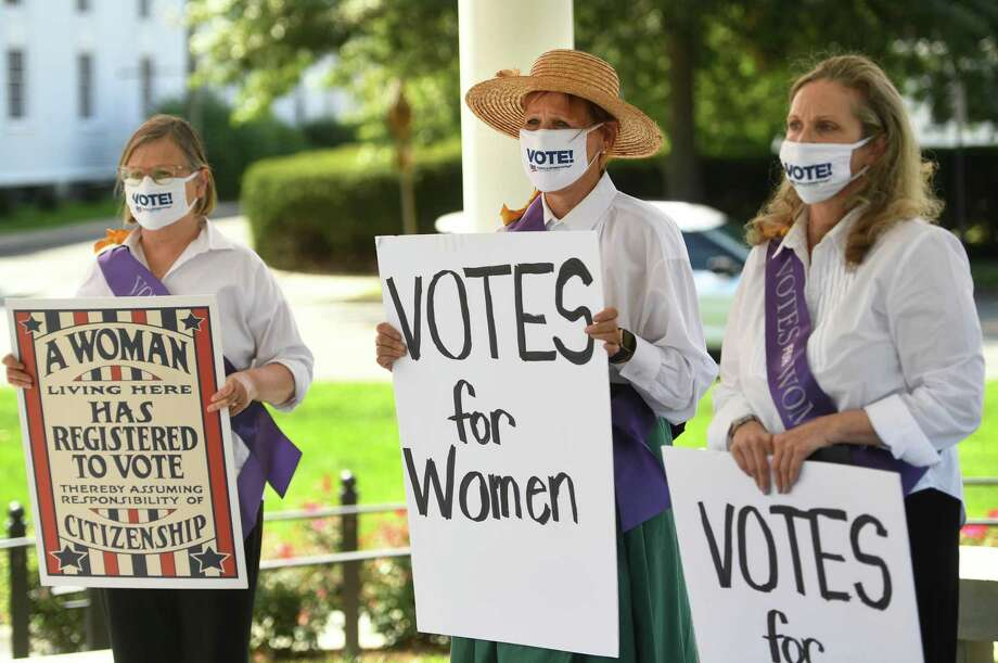 From left; Norwalk League of Women Voters members Debra D'Arinzo, Mary Oster, and Laura Smits commemorate the 100th anniversary of the passing of the 19th Amendment, giving women the right to vote, on the Green in Norwalk, Conn. on Tuesday, August 25, 2020. The Norwalk LWV is holding a virtual debate Thursday, Oct. 22, 2020 for candidates in the upcoming elections. Photo: Brian A. Pounds / Hearst Connecticut Media / Connecticut Post