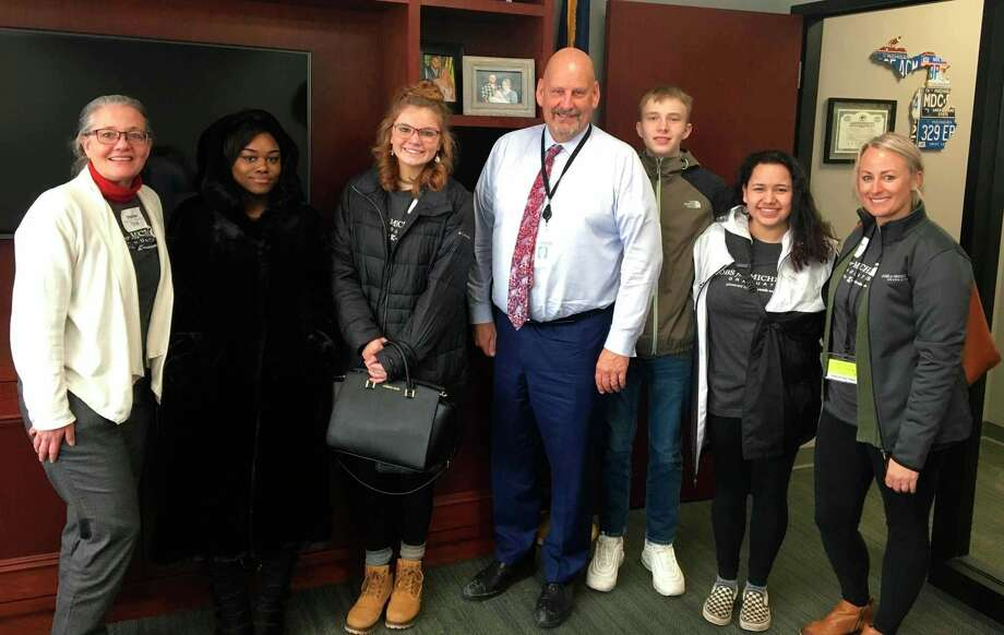 CASMAN Academy student Jessey Abrom was part of a Jobs for Michigan's Graduates students and staff members who met with State Sen. Curt VanderWall at the JMG Legislative Day in Lansing this past winter. (File photo)