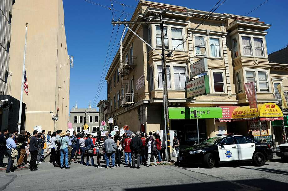 Tenants and activists protest in front of the Vallejo Emery Apartments in Chinatown who's owner they say is trying to evict longtime residents so that the rooms can be rented to higher paying tech workers, in San Francisco, CA, on Thursday, March 26, 2015. Photo: Michael Short / Special To The Chronicle 2015