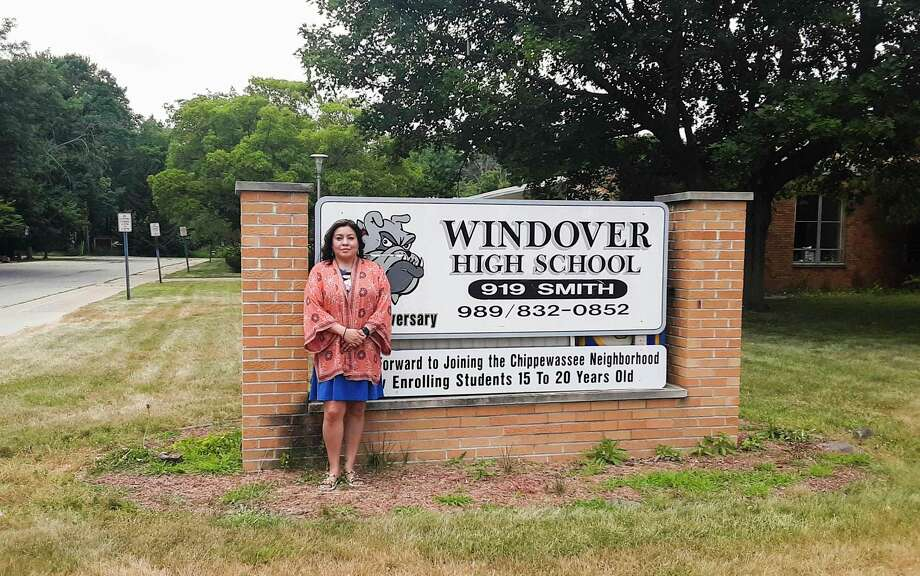Windover High School Principal Marcella Mosqueda stands in front of the school last summer while renovations were taking place after the flooding in May. (Dan Chalk/chalk@mdn.net)