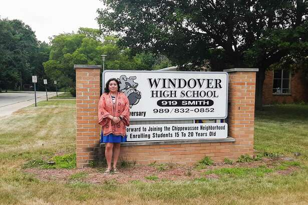 Windover High School Principal Marcella Mosqueda stands in front of the school on Tuesday, which is undergoing extensive repairs after the May flooding in hopes of being open in time for the first day of the fall semester on Aug. 31. (Dan Chalk/chalk@mdn.net)