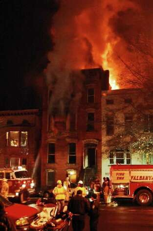 Firefighters work at the scene of a fire on Dec. 11, 2007, at 598 Madison Ave., Albany. ( Times Union archive )