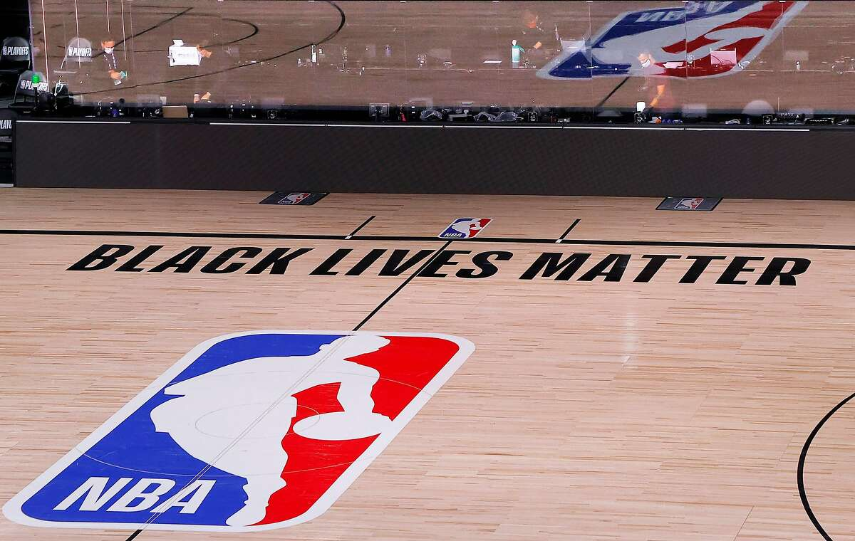 An empty court and bench is shown with no signage following the scheduled start time in Game Five of the Eastern Conference First Round between the Milwaukee Bucks and the Orlando Magic during the 2020 NBA Playoffs at AdventHealth Arena at ESPN Wide World Of Sports Complex on Aug. 26, 2020 in Lake Buena Vista, Fla.
