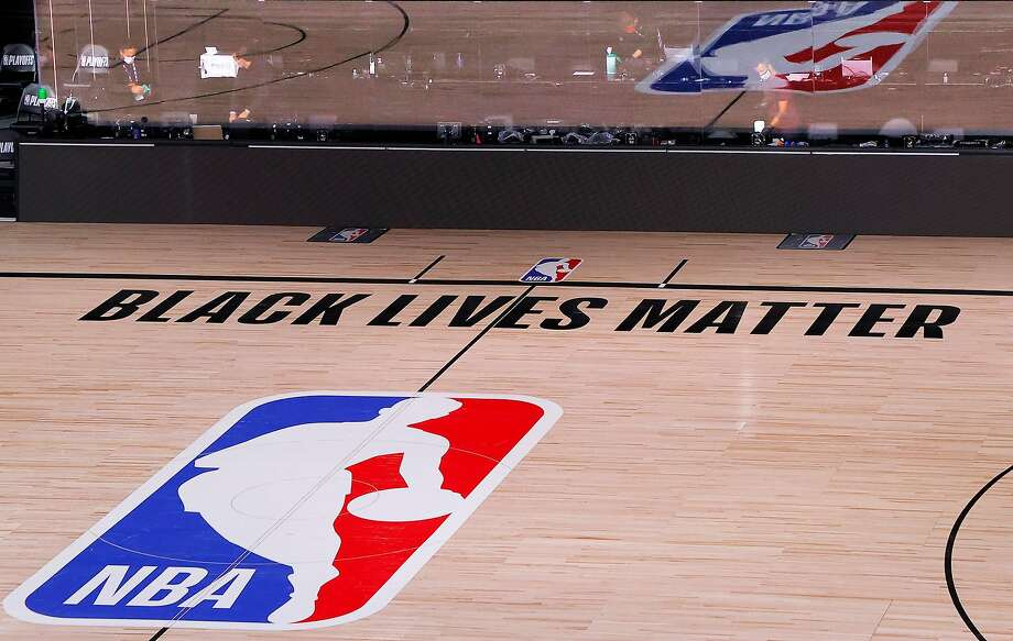 An empty court and bench is shown with no signage following the scheduled start time in Game Five of the Eastern Conference First Round between the Milwaukee Bucks and the Orlando Magic during the 2020 NBA Playoffs at AdventHealth Arena at ESPN Wide World Of Sports Complex on Aug. 26, 2020 in Lake Buena Vista, Fla. Photo: Kevin C. Cox, Getty Images
