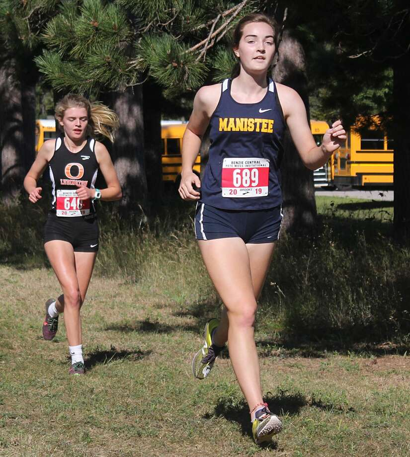 Manistee's Brynn O'Donnell runs during last year's Moss Invitational. O'Donnell and the Chippewas will return to this year's race on Saturday. (News Advocate file photo) Photo: News Advocate File Photo