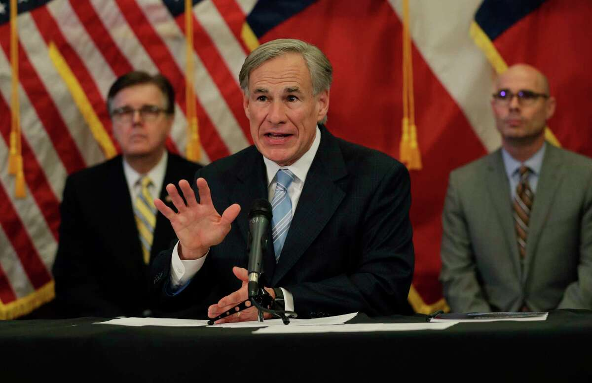 Texas Gov. Greg Abbott, center, with Lt. Gov. Dan Patrick, left, and Texas House Speaker Dennis Bonnen, right, speaks during an April news conference about the state's response to the COVID-19 pandemic.