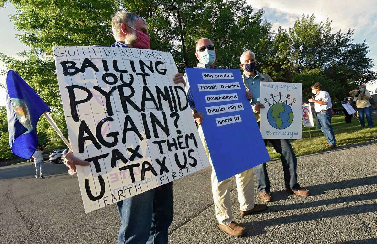 Protesters gather outside of Guilderland Town Hall to push the planning board to do a complete environmental review of the plan to build a Costco warehouse store next to Crossgates Mall on Wednesday, Aug. 26, 2020 in Guilderland, N.Y (Lori Van Buren/Times Union)