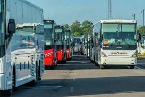 Buses are ready to pick up people to evacuate them from the path of the hurricane. Before winds from Hurricane Laura begin picking up, more than 100 emergency vehicles staged at Ford Park. Photo made on August 26, 2020.  Fran Ruchalski/The Enterprise