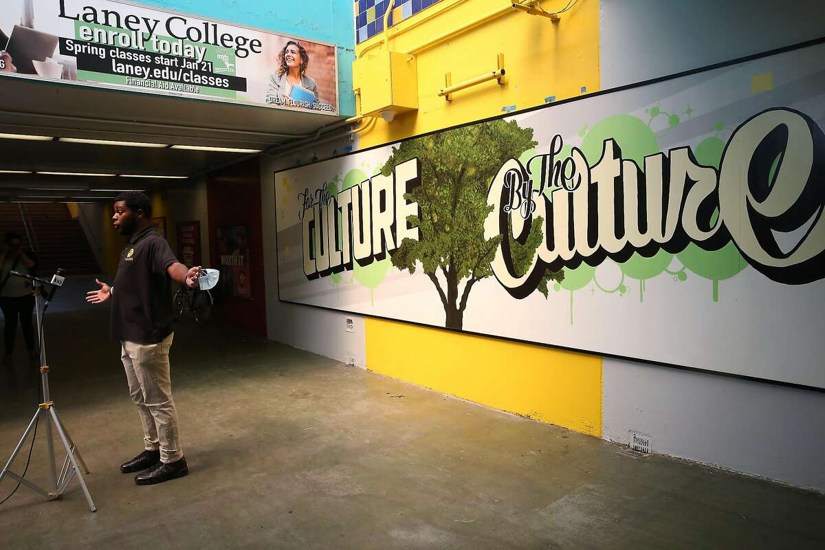 """BART interns Hezekiah Pemberton speaks at a press conference after the mural """"For the Culture, By the Culture"""" was unveiled at the Coliseum BART Station on Friday, August 21, 2020 in Oakland, Calif."""