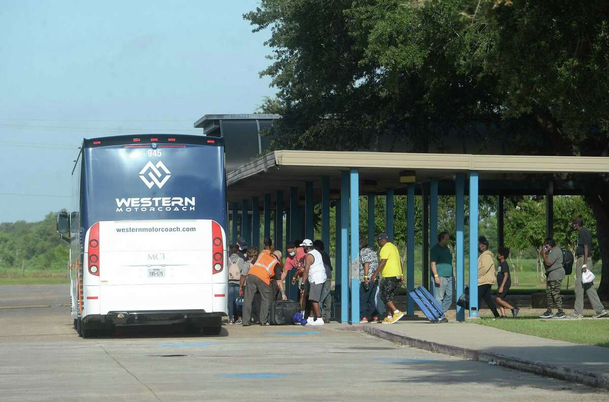 Residents board buses at West brook High School in Beaumont Wednesday as residents evacuate or make final preparations to ride out the storm. Photo taken Wednesday, August 26, 2020 Kim Brent/The Enterprise